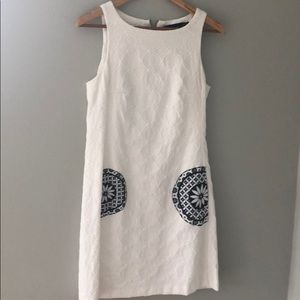 Sleeveless white embossed canvas shift dress